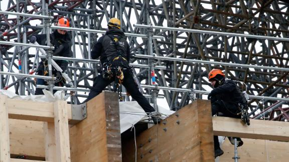 Professional mountain climbers work on a part of the Notre Dame Cathedral restoration on January 29.