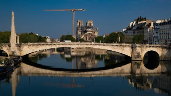Notre Dame and the Pont de la Tournelle bridge are reflected in the Seine river on Easter Sunday, April 12.