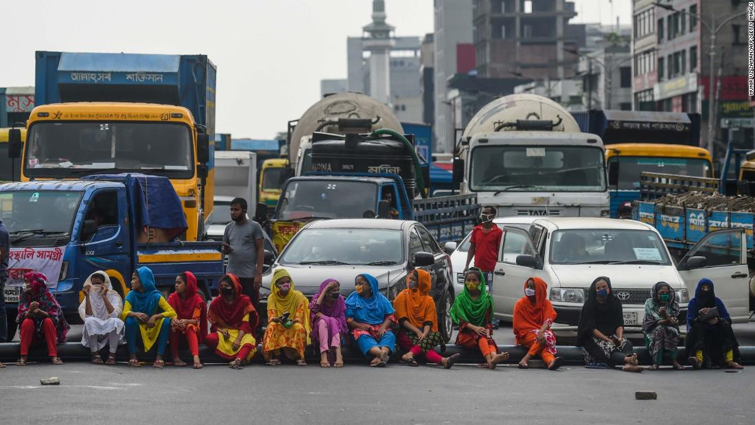 Workers from the garment sector in Dhaka, Bangladesh, block a road during a protest demanding payment of unpaid wages.