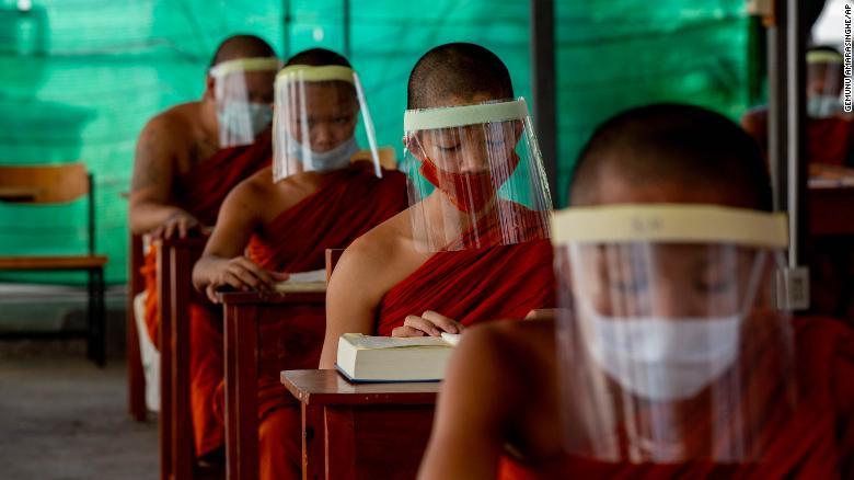 Novice Buddhist monks wear face shields at the Molilokayaram Educational Institute in Bangkok, Thailand, on Wednesday, April 15.
