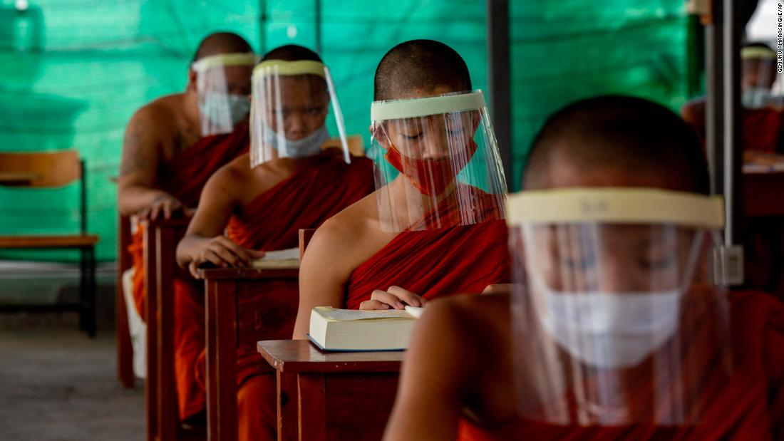 Novice Buddhist monks wear face shields at the Molilokayaram Educational Institute in Bangkok, Thailand, on Wednesday, April 15.