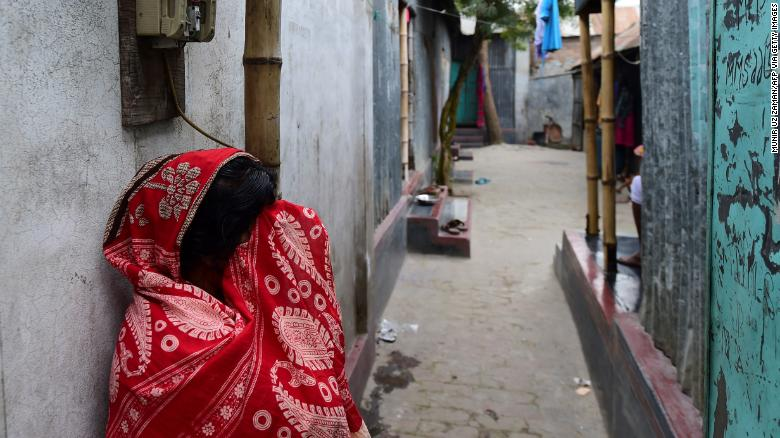 A sex worker in front of a brothel in Daulatdia, Bangladesh, on February 8.