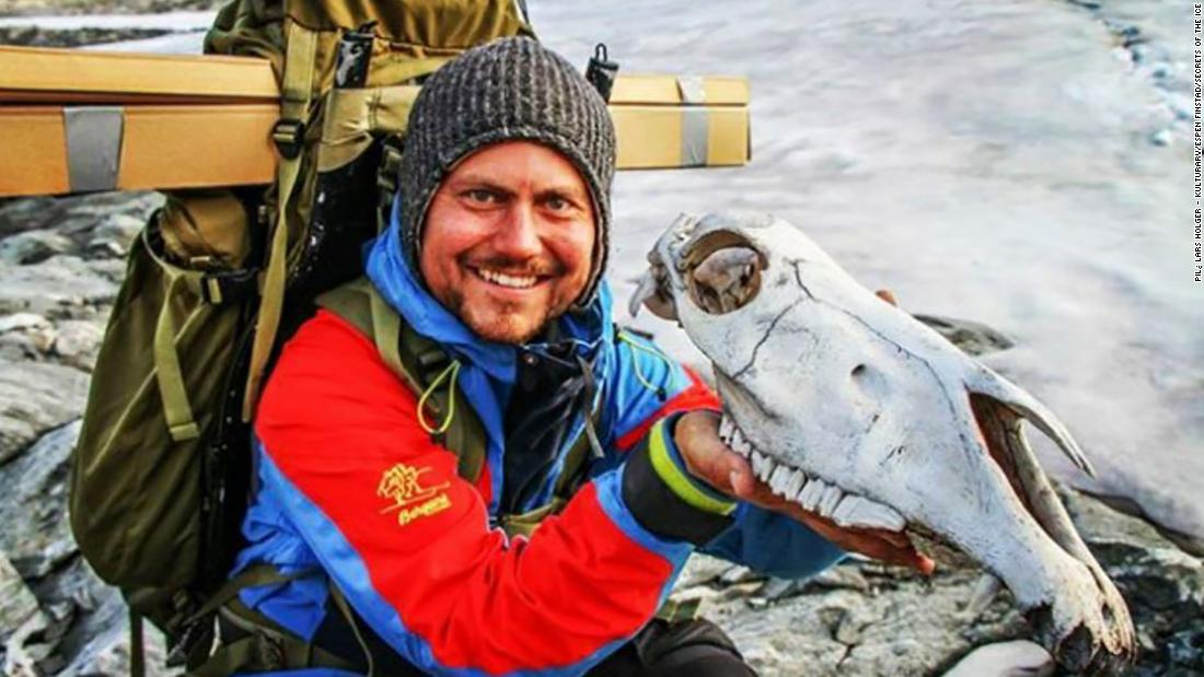 Researcher Elling Utvik Wammer holds the skull of an unlucky packhorse that did not survive its journey. The skull was dated to 1700 AD, making it the most recent item found at the site.