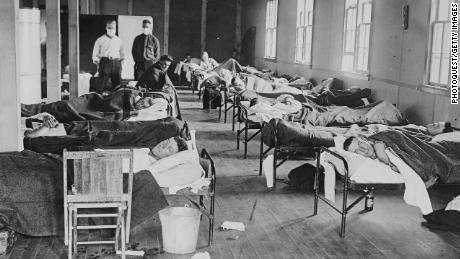 Flu patients lie in a barracks hospital at Colorado Agricultural College in Fort Collins, Colorado, in 1918.