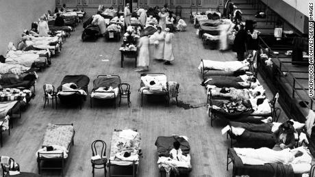 The Oakland Municipal Auditorium in California was converted to a temporary hospital with volunteer nurses from the American Red Cross in 1918.