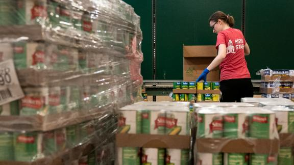 Volunteers at the Capital Area Food Bank pack up boxes of food to be distributed in Washington, DC.
