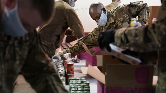 National Guard members help pack food boxes at the Nourish Pierce County food bank in Tacoma, Washington.