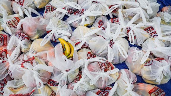 Bags of fruit await residents during a food drive in Waltham, Massachusetts.