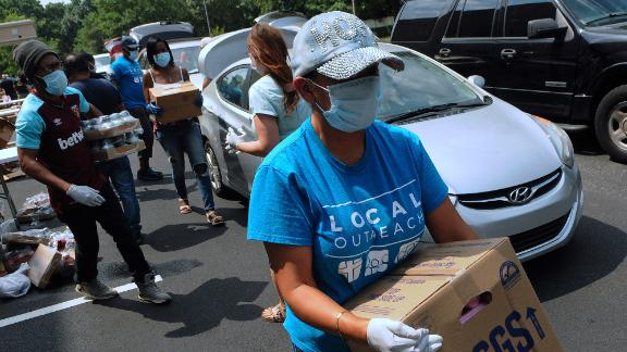Volunteers in Orlando hand out food from the Second Harvest Food Bank of Central Florida.