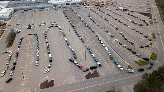 Cars line up in a mall parking lot that was the site of a drive-through food pantry in Grand Rapids, Michigan.