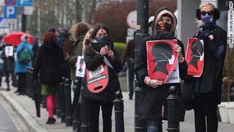 Women's rights activists, wearing masks against the spread of the coronavirus in Warsaw, Poland, on April 15, 2020.