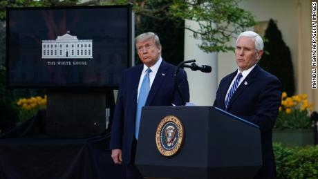 US President Donald Trump (L) listens as US Vice President Mike Pence speaks during the daily briefing on the novel coronavirus, which causes COVID-19, at the White House on April 15, 2020, in Washington, DC. (Photo by MANDEL NGAN / AFP) (Photo by MANDEL NGAN/AFP via Getty Images)