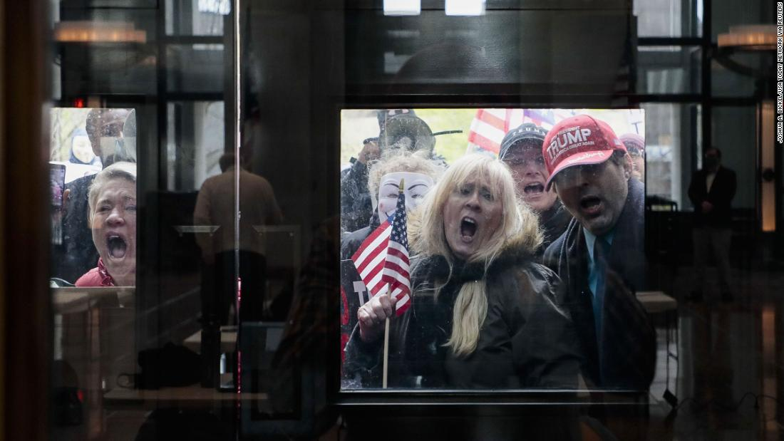 "Protesters stand outside the Statehouse Atrium in Columbus, Ohio, on Monday, April 13, <a href=""https://www.cnn.com/2020/04/16/us/protests-coronavirus-stay-home-orders/index.html"" target=""_blank"">to voice their opposition to stay-at-home orders.</a> About 100 protesters assembled outside the building during Gov. Mike DeWine's weekday update on the state's response to the pandemic. Michigan, Ohio, Kentucky, North Carolina and Utah have all seen protests in recent days as people grow more concerned about the pandemic's economic fallout."