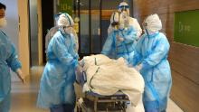 Medical staffs wearing protective gears hold an exercise for coronavirus outbreak at a hospital on February 7, 2020 in Tottori, Japan.