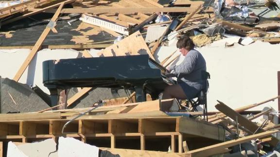 Tracy Lynn Coats plays a piano in the rubble of a church in Chatanooga, Tennessee on Wednesday, April 15, 2020.