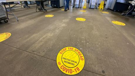 Six-foot markers for social distancing have been painted at UPS's Worldport facility in Louisville.