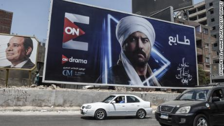 Billboards for TV Ramadan series are seen in the streets of the Egyptian capital Cairo on May 15, 2018. - Soaps and dramas normally united binge-watching Arab audiences during Ramadan but this year an Egyptian series has been caught up in a bitter dispute with Saudi Arabia over one of its star actors. (Photo by MOHAMED EL-SHAHED / AFP)        (Photo credit should read MOHAMED EL-SHAHED/AFP via Getty Images)