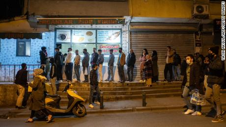People queue at shops for food and supplies shortly before the curfew in Istanbul, on April 10, 2020, as Turkey ordered citizens to stay at home for 48 hours across 31 cities including Istanbul and Ankara, from April 10 at midnight, to contain the spread of the COVID-19, caused by the novel coronavirus. (Photo by Yasin AKGUL / AFP) (Photo by YASIN AKGUL/AFP via Getty Images)