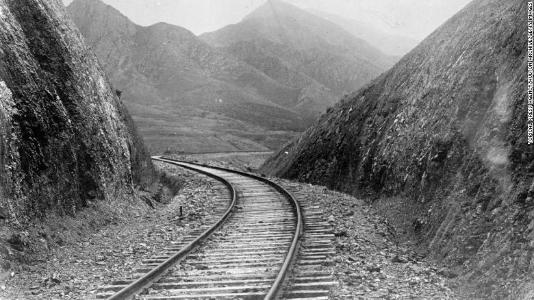 A railway cutting through the hills of Manchuria, circa 1906.