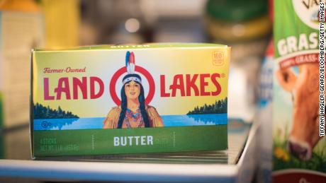 A container of Land O'Lakes brand butter showing its old logo.