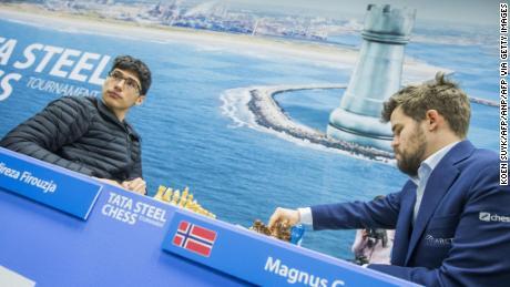 Firouzja (left) faces world champion Carlsen.