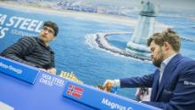 Firouzja (left) faces World Champion Carlsen during the 9th round of the Tata Steel Chess Tournament.