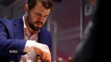 Carlsen competes against Daniil Dubov of Russia.