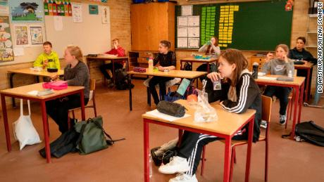 Students are separated during their lunch break at Korshoejskolen Public school in Randers, Denmark as schools reopened for younger children after a month on April 15.
