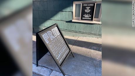 A sign sits in front of Ramirez's kitchen window offering free coffee.