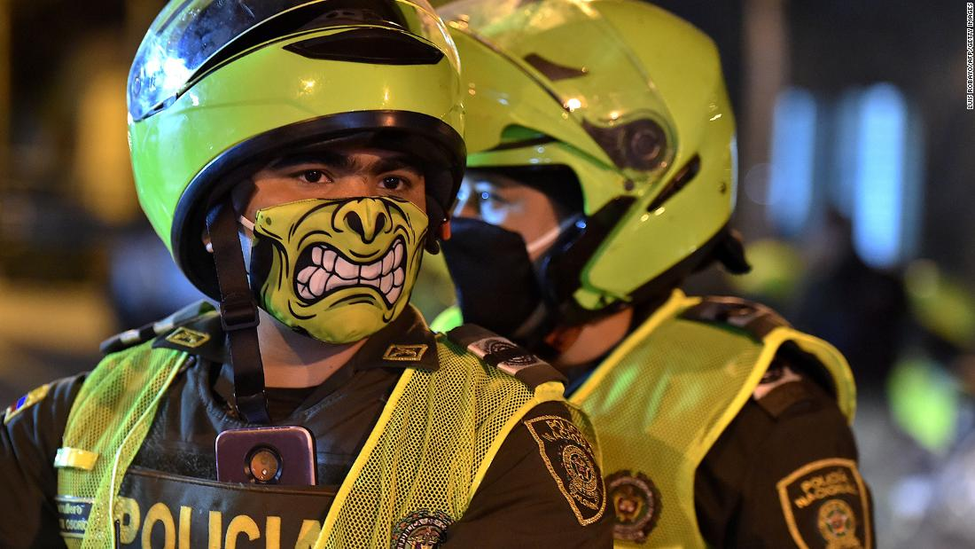 Police officers wear face masks in Cali, Colombia.
