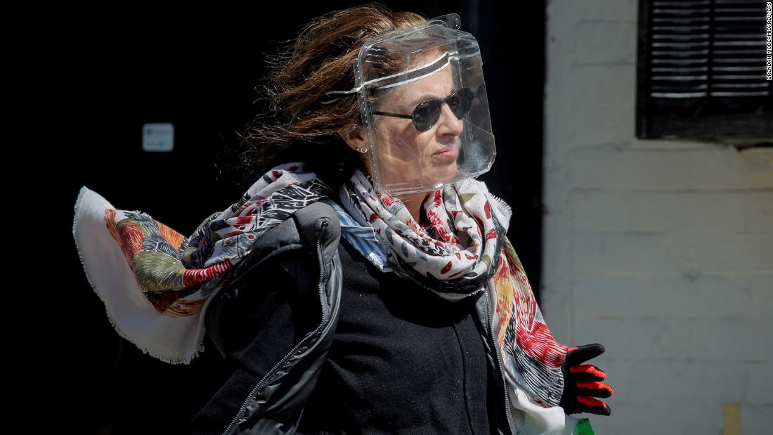 A woman in New York wears a plastic food container for protection.
