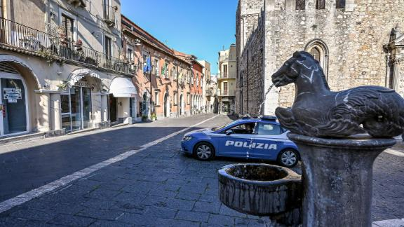 TAORMINA , ITALY - APRIL 08: A police car patrols an empty downtown street after government restrictions to avoid spread of Covid-19 on April 08, 2020 in Taormina, Italy. There have been well over 100,000 reported COVID-19 cases in Italy and more than 15,000 related deaths, but the officials are confident the peak of new cases has passed. (Photo by Fabrizio Villa/Getty Images)
