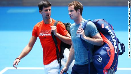 Djokovic talks with Murray before their practice match ahead of the 2019 Australian Open.