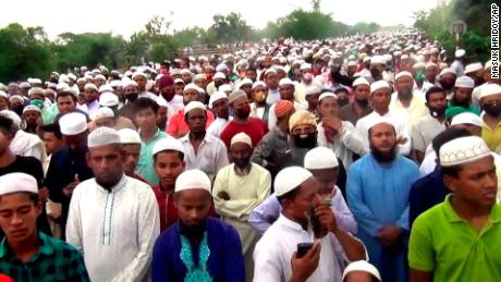 Thousands of Bangladeshi Muslims gather for the funeral of a popular Islamic preacher on Saturday, April 18, 2020.
