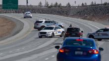 Police block the highway in Enfield, Nova Scotia on Sunday, April 19, 2020. Canadian police on Sunday arrested a suspect in an active shooter investigation after earlier saying he may have been driving a vehicle resembling a police car and wearing a police uniform.