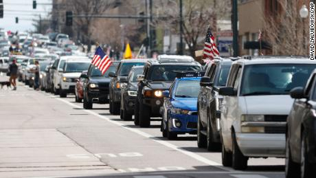 Vehicles stack up  in Boulder during a car protest against the stay-at-home order issued by Colorado Gov. Jared Polis on Sunday, April 19, 2020.