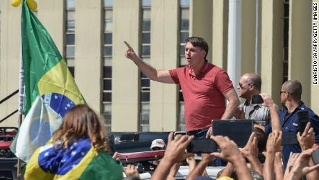 Brazilian President Jair Bolsonaro speaks after joining his supporters to protest quarantine and social distancing measures on April 19, 2020.