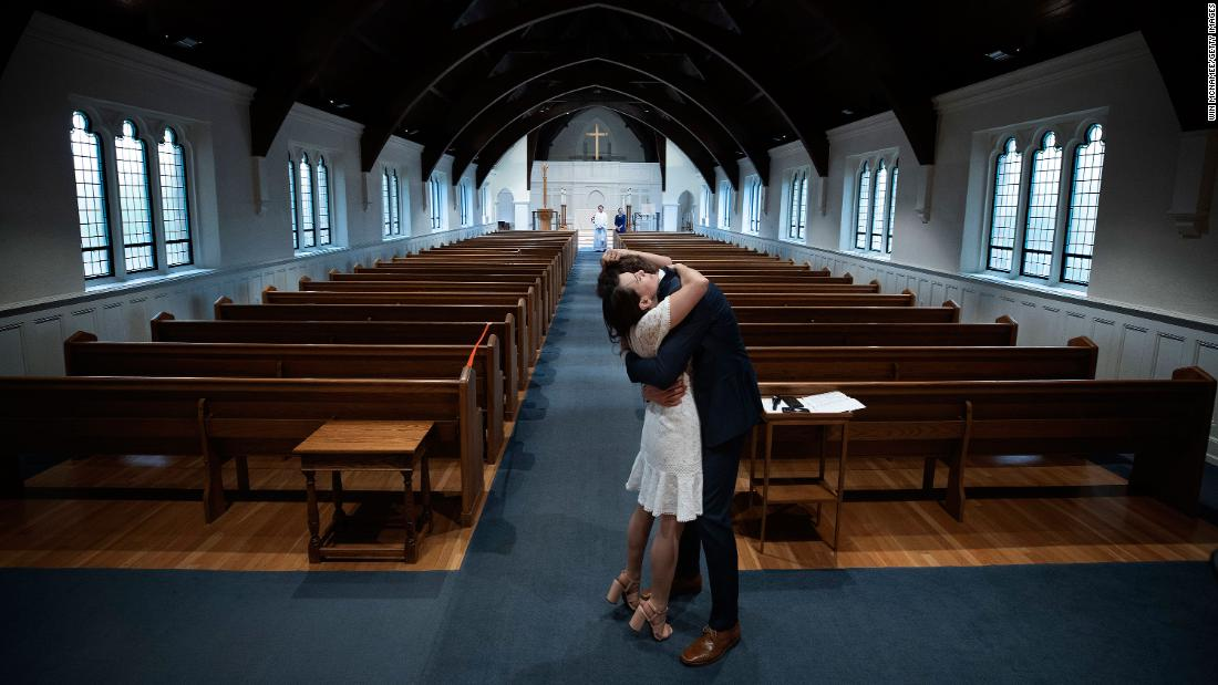 Newly married Tyler and Caryn Suiters embrace following their marriage ceremony in Arlington, Virginia, on April 18. The Rev. Andrew Merrow and his wife, Cameron, were the only other attendees at the ceremony, which was held at St. Mary's Episcopal Church.