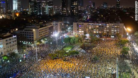 Thousands of Israelis protest against Netanyahu, two meters apart