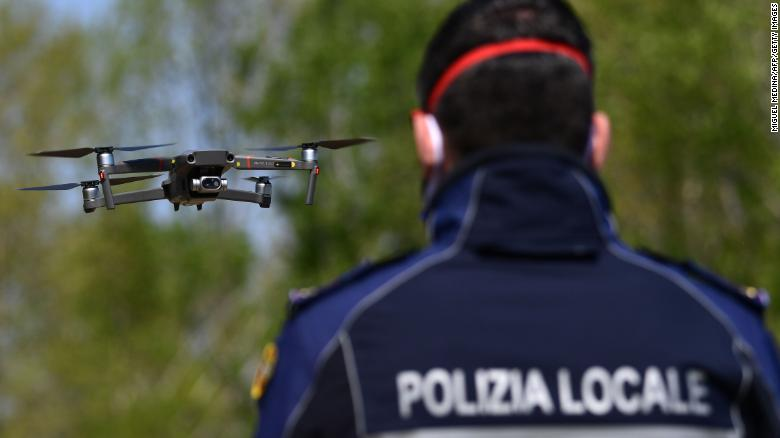 A police officer pilots a DJI Mavic 2 Enterprise drone with a thermal sensor for checking people's temperature on April 9 in Treviolo, near Bergamo, Italy.