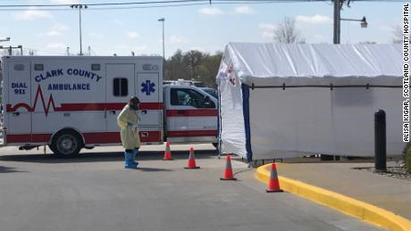 An emergency room worker at Memphis, Missouri's Scotland County Hospital prepares to triage incoming patients.