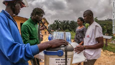 A motorcycle driver loads vaccines to be transported further in rural areas in western DRC on March 3, 2020.