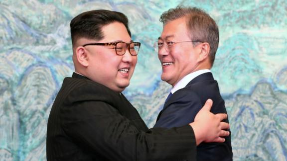 Kim and Moon embrace after signing a joint statement at their summit in April 2018.
