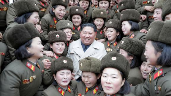 Kim is surrounded by troops in this undated photo released by the country