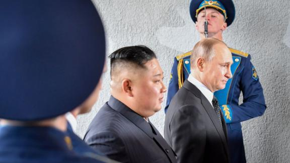 Kim and Putin pass by guards during their meeting in Vladivostok, Russia.