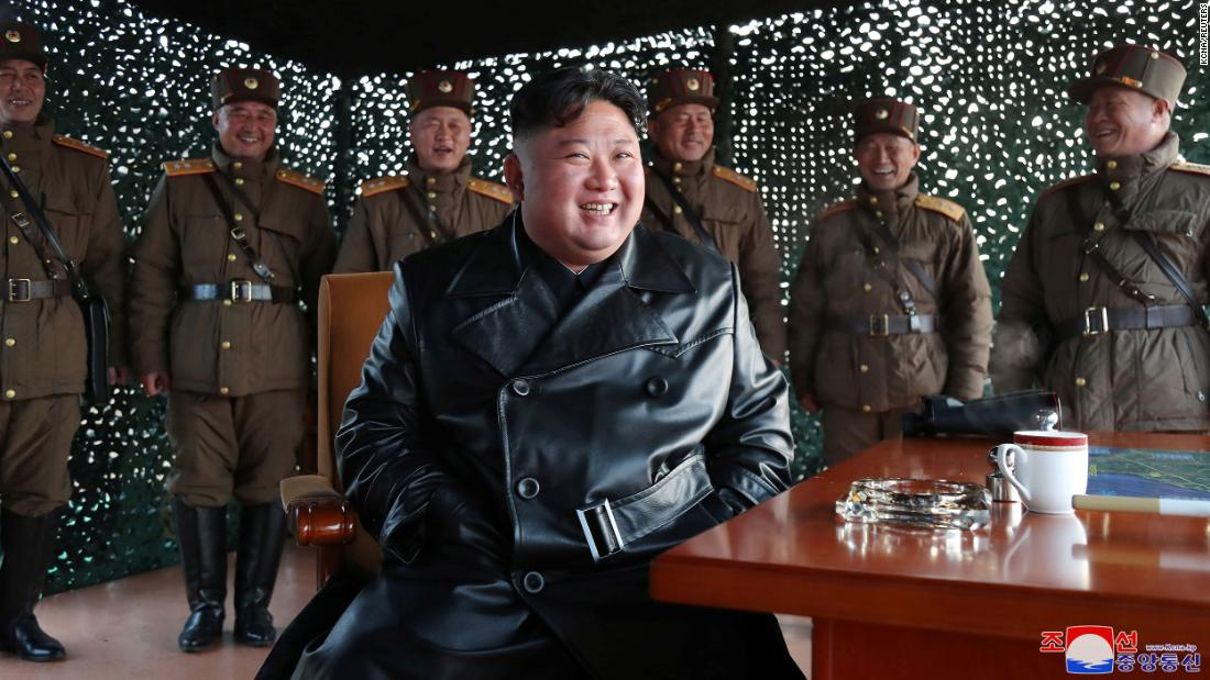 Kim Jong Un seen laughing, smiling, smoking and waving to crowds, North  Korea state media reports - CNN