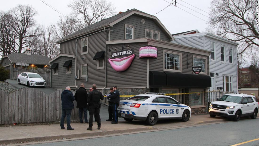 HALIFAX, CANADA - APRIL 20: Regional police investigators confer outside the Atlantic Denture Clinic April 20, 2020 in Dartmouth, Nova Scotia ,Canada. The clinic was owned by the gunman, Gabrielle Wortman, who police say is responsible for Sundays killing spree that resulted in the death of 19, including Wortman. The rampage began late Saturday night in Portapique as well as several other rural communities in the Maritime province. (Photo by Tim Krochak/Getty Images)