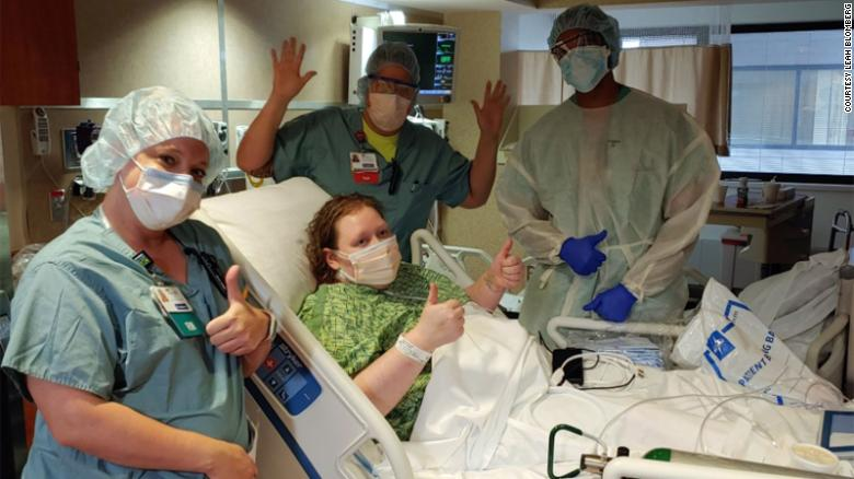 Leah Blomberg celebrates with medical staff after spending 18 days hospitalized with coronavirus.