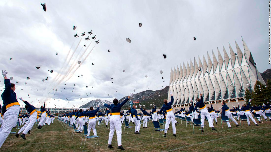 "The class of 2020 tosses hats into the air at the <a href=""https://www.cnn.com/2020/04/18/politics/mike-pence-air-force-academy-commencement-speech/index.html"" target=""_blank"">Air Force Academy graduation</a> in Colorado Springs, Colorado."