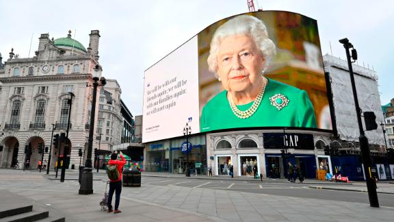 An image of the Queen appears in London's Piccadilly Square, alongside a message of hope from her special address to the nation in April 2020.